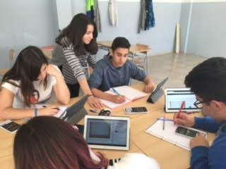 Students from IES MZaragoza testing COMPASS material using tablets